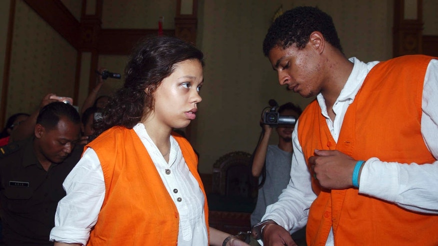 FILE - In this March 31, 2015, file photo, Heather Mack, left, and her boyfriend Tommy Schaefer, of Chicago, are handcuffed as they arrive at a courtroom during their trial in Bali, Indonesia.