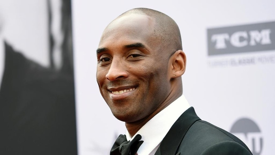 In this June 9, 2016 file photo, retired NBA basketball player Kobe Bryant poses at the 2016 AFI Life Achievement Award Gala Tribute to John Williams in Los Angeles.