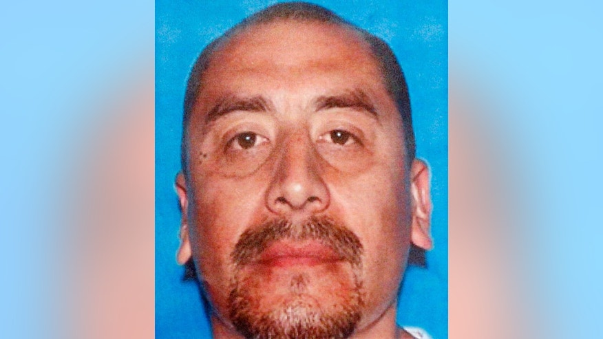 This undated photo provided by the Los Angeles Police Department shows Joseph Monge. Monge is one of three suspects arrested in a deadly fire that struck an apartment building in the Westlake district of Los Angeles in 1993, taking the lives of 12 people including the deaths of late-term fetuses. Police Chief Charlie Beck says two men were arrested Feb. 3, 2017, and a woman was already in custody in connection with the fire. One suspect was still being sought. (Los Angeles Police Department via AP)