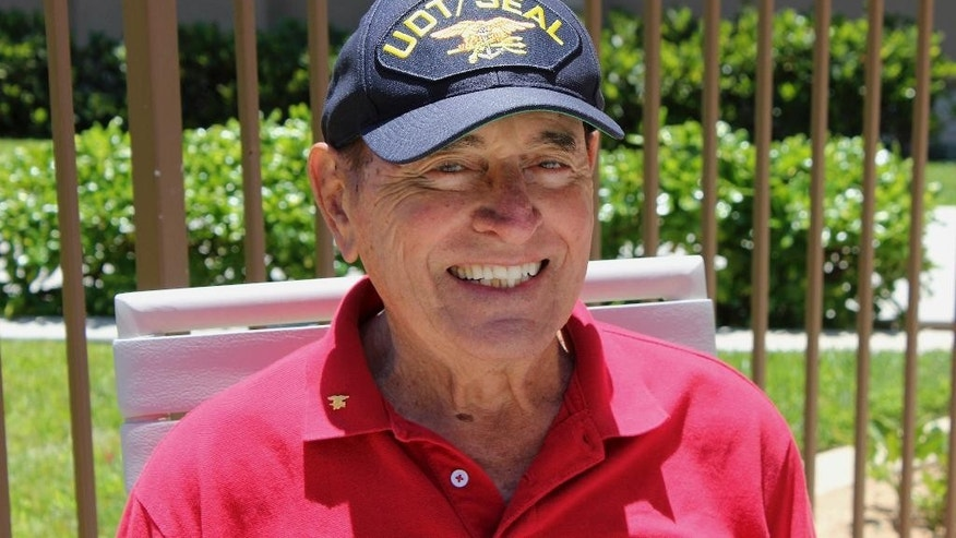 "This 2012 photo provided by the Lyon family shows Adm. Richard ""Dick"" Lyon. Lyon, the first Navy SEAL to rise to the rank of admiral, has died. He was 93. Lyon died Friday, Feb. 3, 2017, surrounded by family and friends at his beachfront home in Oceanside, north of San Diego. He served four decades in the Navy, including World War II and the Korean War. (Courtesy of the Lyon family via AP)"