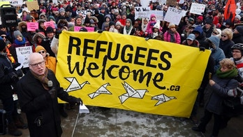 Thousands of people protest against the U.S. immigration policy of U.S. President Donald Trump, at the United States embassy in Ottawa, Monday, Jan. 30, 2017. (Fred Chartrand/The Canadian Press via AP)