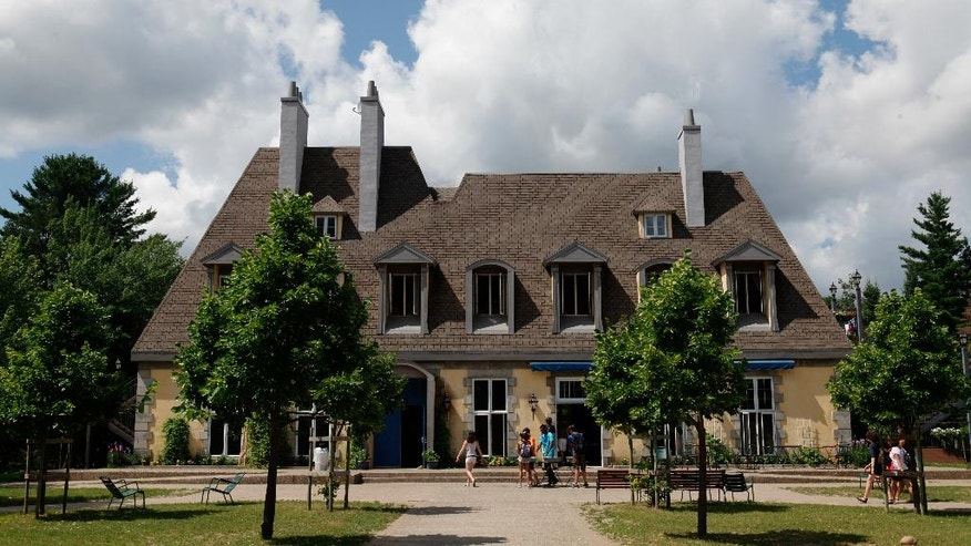 This 2011 photo provided by Concordia Language Villages, shows campers immersed in a culturally authentic setting around this Parisian-style building at the French Language Village in Bemidji, Minn. (Concordia Language Villages via AP)