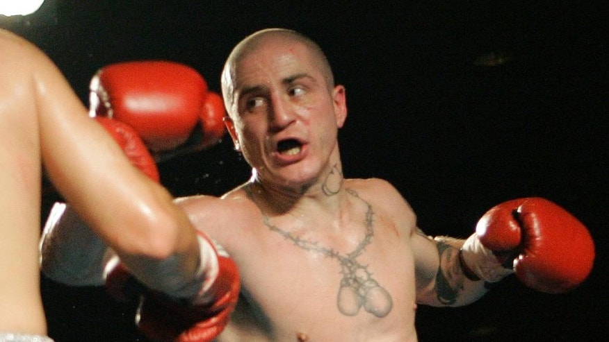 FILE – In this Nov. 22, 2006, file photo, Paul Spadafora boxes against Jesus Francisco Zepeda in a bout in Erie, Pa. Prosecutors have dropped assault and other charges against Spadafora that involving relatives but he faces other counts involving his alleged conduct involving police officers. Spadafora had been accused of stabbing his brother and kicking his mother during a family dispute in December, but Allegheny County prosecutors said Wednesday, Feb., 8, 2017, that his relatives haven't come to court to testify. (AP Photo/Keith Srakocic, File)
