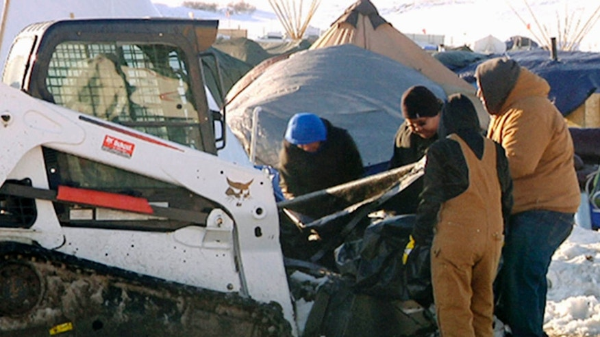 This Monday, Jan. 30, 2017, photo from video provided by KXMB in Bismarck, N.D., shows cleanup beginning at a North Dakota encampment near Cannon Ball where Dakota Access oil pipeline opponents have protested for months.