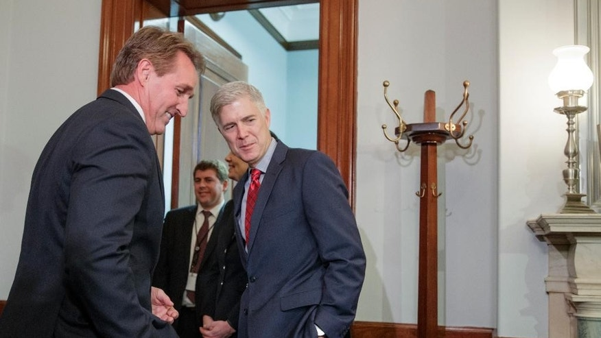 Supreme Court Justice nominee Neil Gorsuch meets with Senate Judiciary Committee member Sen. Jeff Flake, R-Ariz., Wednesday, Feb. 8, 2017, on Capitol Hill in Washington. (AP Photo/J. Scott Applewhite)