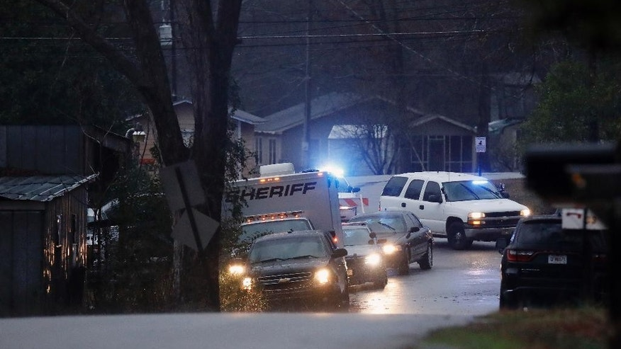 "A man suspected in the killings of three women is dead after a standoff Tuesday, Feb. 7, 2017, with police at a Georgia motel, and a female suspect has been arrested, a U.S. Marshals Service spokesman said. William ""Billy"" Boyette, 44, was dead after the standoff in West Point, Ga., and authorities had taken 37-year-old Mary Rice into custody, U.S. Marshals Service spokesman Jim Joyner said in an email. The pair had holed up inside a room at the motel. (Todd J. Van Emst/Opelika-Auburn News via AP)"