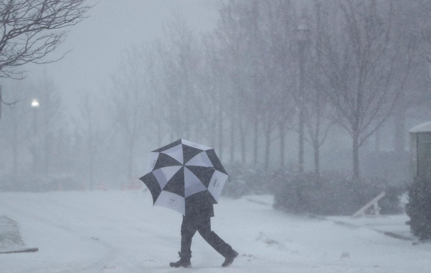 A person shields itself from falling snow with an umbrella, Thursday, Feb. 9, 2017, in Jersey City, N.J. A powerful, fast-moving storm swept through the northeastern U.S. Thursday, making for a slippery morning commute and leaving some residents bracing for blizzard conditions. (AP Photo/Matt Rourke) (AP Photo/Julio Cortez)