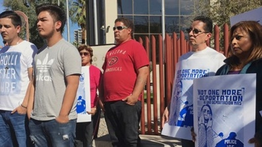 Members of the family of Guadalupe Garcia de Rayos, left, stand with supporters at a news conference in front of the U.S. Immigration and Customs Enforcement office in Phoenix. Garcia de Rayos was deported Thursday Feb. 9, 2017 morning after protests. The advocates say she is among the first immigrants to be deported under new policies by President Donald Trump as he cracks down on illegal immigration (AP Photo/Steve Fluty)