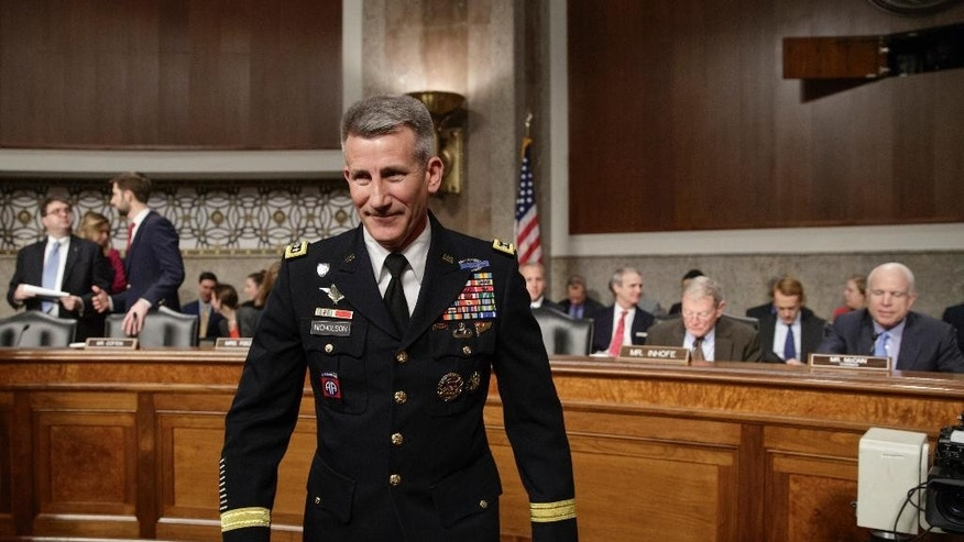 "Gen. John Nicholson, the top U.S. commander in Afghanistan, arrives on Capitol Hill in Washington, Thursday, Feb. 9, 2017, to testify before the Senate Armed Services Senate Committee. Nicholson says he needs a ""few thousand"" more troops to better accomplish a key part of the mission in the war-torn country, adding, Russia's meddling in Afghanistan is proving to be problematic. (AP Photo/J. Scott Applewhite)"