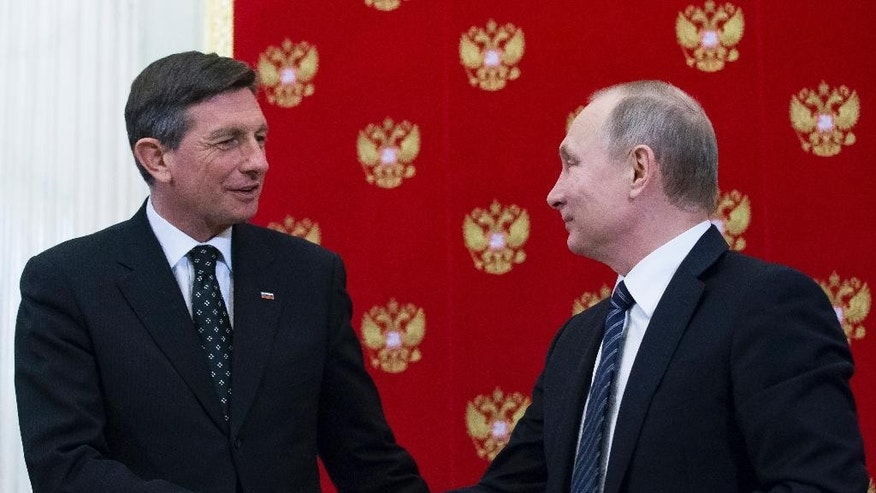 Russian President Vladimir Putin, right, shakes hands with Slovenian President Borut Pahor after a signing ceremony following their talks at the Kremlin in Moscow, Russia, Friday, Feb. 10, 2017. Slovenia's ambassador to Moscow told RIA Novosti news agency that his country could host the first meeting between President Donald Trump and Russian President Vladimir Putin. (AP Photo/Alexander Zemlianichenko, pool)