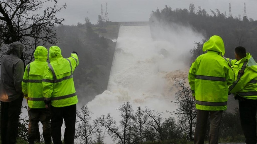 Water rushes down the Oroville Dam spillway, Thursday, Feb. 9, 2017, in Oroville, Calif. State engineers on Thursday discovered new damage to the Oroville Dam spillway, the tallest in the United States, though they said there is no harm to the nearby dam and no danger to the public. Earlier this week, chunks of concrete went flying off the spillway, creating a 200-foot-long, 30-foot deep hole. (AP Photo/Rich Pedroncelli)