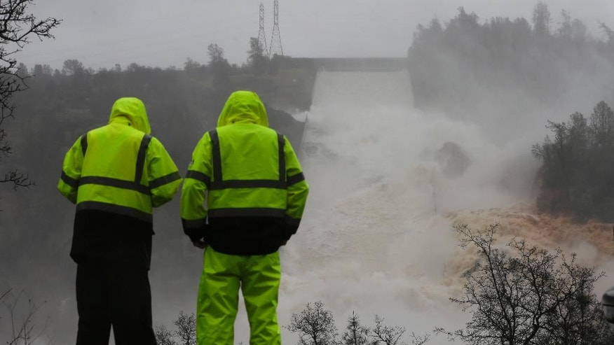 Water rushes down the Oroville Dam spillway, Thursday, Feb. 9, 2017, in Oroville, Calif. State engineers on Thursday discovered new damage to the Oroville Dam spillway in Northern California, the tallest in the United States, though they said there is no harm to the nearby dam and no danger to the public. Earlier this week, chunks of concrete went flying off the spillway, creating a 200-foot-long, 30-foot deep hole. (AP Photo/Rich Pedroncelli)