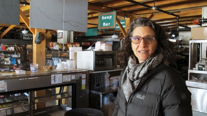 Lyssa Papazian, of the Putney Historical Society, stands inside the closed Putney General Store, in Putney, Vt., on Feb. 6, 2017. (AP Photo/Wilson Ring)
