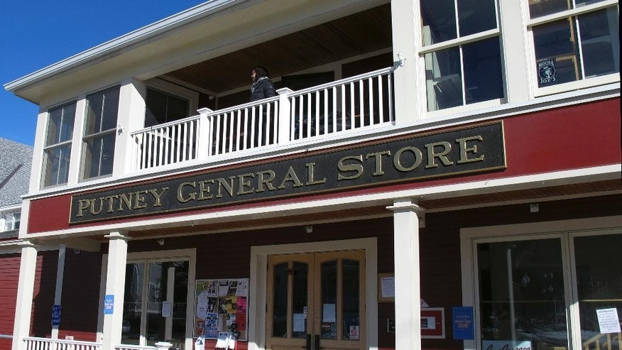 In this Monday Feb. 6, 2017 photo, Lyssa Papazian, of the Putney Historical Society, stands on a balcony of the closed Putney General Store, in Putney, Vt.  (AP Photo/Wilson Ring)