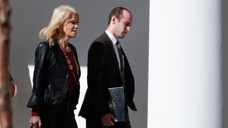 Kellyanne Conway, left, and Stephen Miller, both senior advisers to President Donald Trump, walk to a news conference with President Donald Trump and Japanese Prime Minister Shinzo Abe, Feb. 10, 2017, at the White House in Washington. (AP Photo/Evan Vucci)