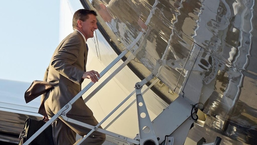 In this Feb. 12, 2017, photo, National Security Adviser Michael Flynn boards Air Force One at Palm Beach International Airport in West Palm Beach, Fla., as he return to Washington with President Donald Trump. Flynn resigned as President Donald Trump's national security adviser Monday, Feb. 13, 2017. (AP Photo/Susan Walsh)