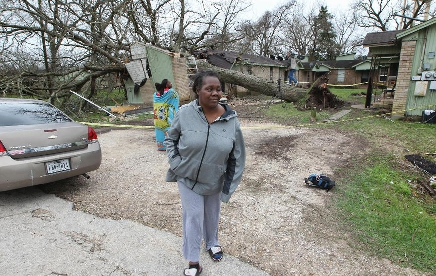Faye Green was rescued through a bedroom window by her daughter, Myesha Byars after a large pecan tree fell on her home Tuesday, Feb. 14, 2017 in Wharton, Texas. Tornadoes are suspected of damaging homes and injuring people Tuesday southwest of Houston as a strong storm system moved quickly across much of the state. ( Steve Gonzales/Houston Chronicle via AP)