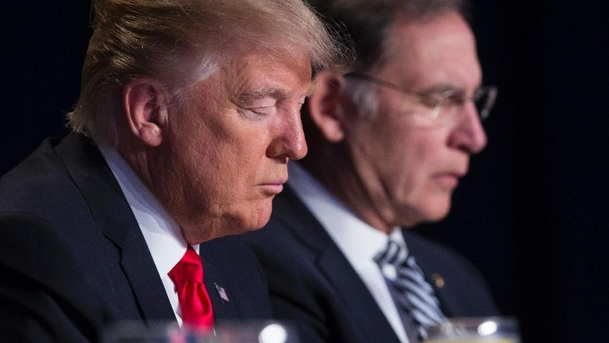 FILE - In this Feb. 2, 2017, file photo, President Donald Trump and Sen. John Boozman, R-Ark., pause during the National Prayer Breakfast in Washington. When Trump spoke to the National Prayer Breakfast this month, he underscored his vow to defend the religious rights of the conservative Christians who helped propel him to power. Now, they expect the Justice Department under new Attorney General Jeff Sessions will reposition itself as a champion of what they see as that religious freedom. (AP Photo/Evan Vucci, File)