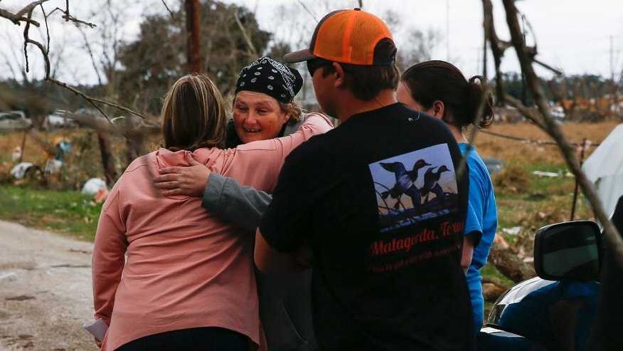Carrie Casey, left, hugs her friend, Sally Farley, after Farley's home was destroyed during a storm Tuesday, Feb. 14, 2017, in Van Vleck, Texas. Tornadoes are suspected of damaging homes and knocking out power southwest of Houston as part of a strong storm system that moved quickly across much of the state. (Michael Ciaglo/Houston Chronicle via AP)