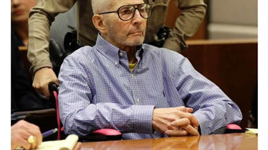 In this Dec. 21, 2016 file photo, real estate heir Robert Durst is brought into a courtroom in a wheelchair for a hearing in Los Angeles