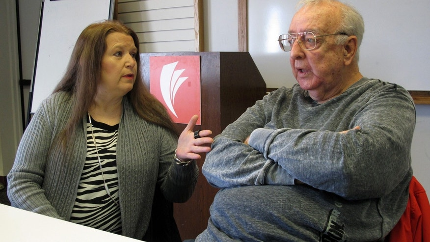 Jan. 30, 2017: Lori Cooper, left, discusses her efforts to bring to trial the suspect who shot her father, Columbus police officer Niki Cooper, in 1972, as Niki Cooper and partner Bob Stout, right, interrupted a burglary, in Columbus, Ohio.