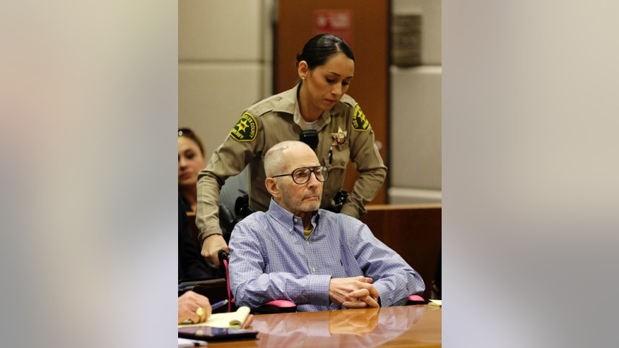 FILE - In this Dec. 21, 2016 file photo, real estate heir Robert Durst is brought into a courtroom in a wheelchair for a hearing in Los Angeles. Before a judge even decides if there's enough evidence to try Durst on an old murder charge, prosecutors plan to start taking testimony. In a rare hearing Tuesday, Feb. 13, 2017, two witnesses will be called to the witness stand against Durst in Los Angeles Superior Court to preserve their testimony in case it is needed later. (AP Photo/Jae C. Hong, Pool, File)