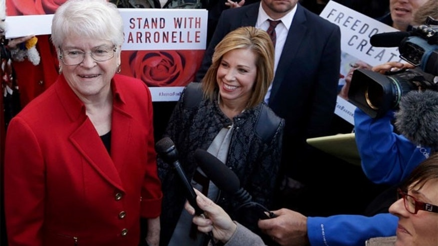 FILE: Barronelle Stutzman, left, was fined for denying service to a gay couple in 2013.