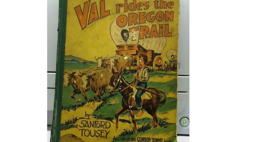 "Robert Lockman Jr. found the book ""Val Rides the Oregon Trail"" in the basement of his home."