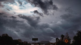 Storm clouds form over the Hollywood Freeway in Los Angeles, Friday, Feb. 17, 2017. Wet weather has returned to California with the first in a new series of rainstorms moving across the northern half of the state while the south awaits a tempest that forecasters say could be the strongest in years if not decades. (AP Photo/Richard Vogel)