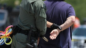 A demonstrator is arrested in front of the White House in Washington, Thursday, July 31, 2014, where faith leaders and activists demonstrated to ask President Barack Obama to modify his deportations policies, on Thursday July 31 2014 in Washington. (AP Photo/Connor Radnovich)