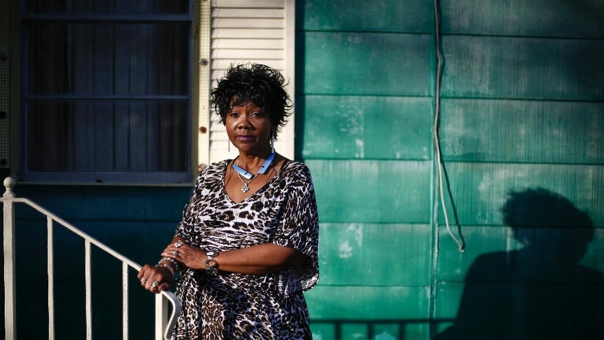 In this Jan. 18, 2017 photo, Chrycynthia Davis, mother of Kharon Davis, poses for a portrait outside of her home in Dothan, Ala. Kharon Davis was 22-years-old when he was arrested on a capitol murder charge in 2007 and booked into the Houston County Jail. Davis has spent nearly a third of his life held without bond in the jail waiting for trial. (AP Photo/Brynn Anderson)