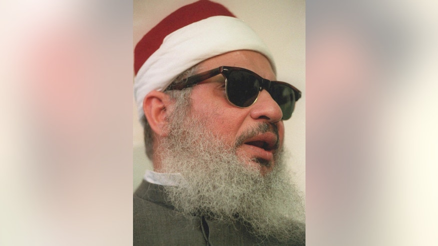 FILE - This April 6, 1993 file photo shows Sheik Omar Abdel-Rahman in New York.   Kenneth McKoy of the Federal Correction Complex in Butner, N.C., said Abdel-Rahman died Saturday, Feb. 18, 2017, after a long battle with diabetes and coronary artery disease. Abdel-Rahman was sentenced to life in prison after his 1995 conviction for his advisory role in a plot to blow up landmarks, including the United Nations, and several bridges and tunnels.  (AP Photo/ Mark Lennihan, file)