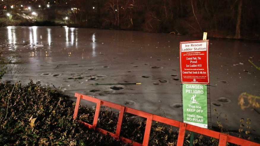 "An ice rescue ladder station sits beside an area in New York's Central Park after several teenagers were rescued when they fell through the ice into the off-limits pond Monday, Feb. 20, 2017, in New York. Police say the 15- and 16-year-olds were on the ice when it gave way. A nearby sign said, ""Danger Thin Ice Keep Off."" (AP Photo/Kathy Willens)"