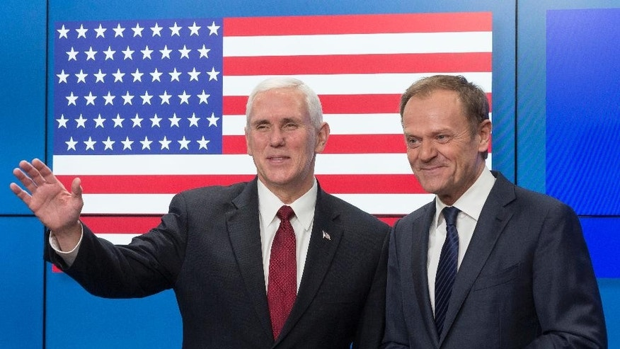 United States Vice President Mike Pence, left, gestures after shaking hands with EU Council President Donald Tusk as he arrives at the European Council building in Brussels, Belgium, on Monday, Feb. 20, 2017. Pence is currently on a one day trip to Brussels to meet with EU and NATO officials. (AP Photo/Thierry Monasse)