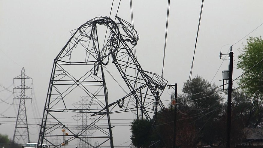 A CPS Energy transmission tower is bent in half Monday, Feb. 20, 2017, in San Antonio. Severe storms pushed at least two tornadoes through parts of San Antonio overnight, ripping the roofs off homes and damaging dozens of other houses and apartments yet causing only minor injuries, authorities said Monday. (Tyler White/The San Antonio Express-News via AP)