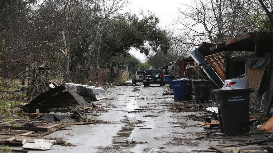 Debris scatters an alley after severe storms moved though the Camelot subdivision of Northeast Bexar County, Texas, Monday, Feb. 20, 2017. (Jerry Lara/The San Antonio Express-News via AP)