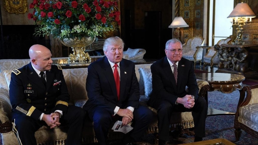 President Donald Trump, center, speaks while seated with Army Lt. Gen. H.R. McMaster, left, and retired Army Lt. Gen. Keith Kellogg, right, at Trump's Mar-a-Lago estate in Palm Beach, Fla., Monday, Feb. 20, 2017, where Trump announced that McMaster will be the new national security adviser.  Kellogg, who had been his acting adviser, will now serve as the National Security Council chief of staff.  (AP Photo/Susan Walsh)