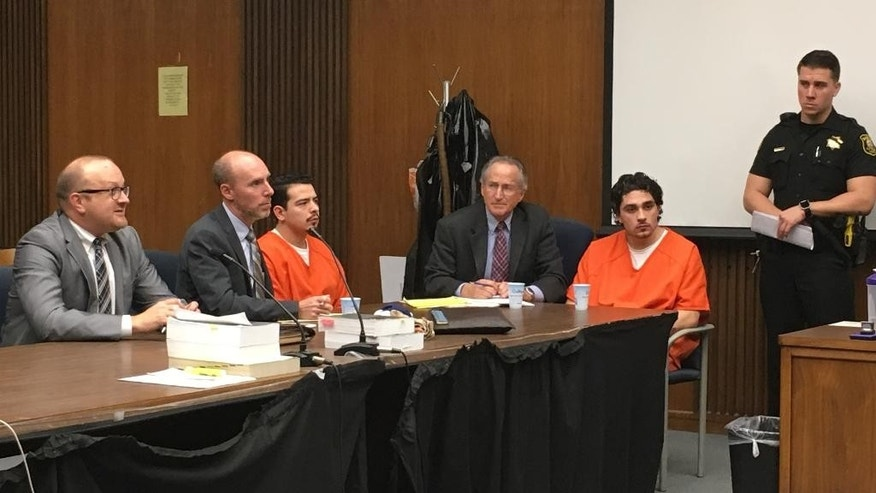 CORRECTS TO POOL PHOTO. CORRECTS SECOND RAMOS REFERENCE IN SECOND SENTENCE TO RUVALCABA - Bank of the West robbers and convicted murderers Jaime Ramos, 22, left, and Pablo Ruvalcaba, 23, right, sit with their attorneys Tuesday, Feb. 21, 2017, in San Joaquin County Superior Court in Stockton, Calif., as Judge Bernard Garber imposes previously agreed upon sentences for their roles in the death of bank customer Misty Holt-Singh. Ramos was sentenced to life without the possibility of parole while Ruvalcaba will serve 25 years to life.   (Joe Goldeen/The Record via AP, Pool)