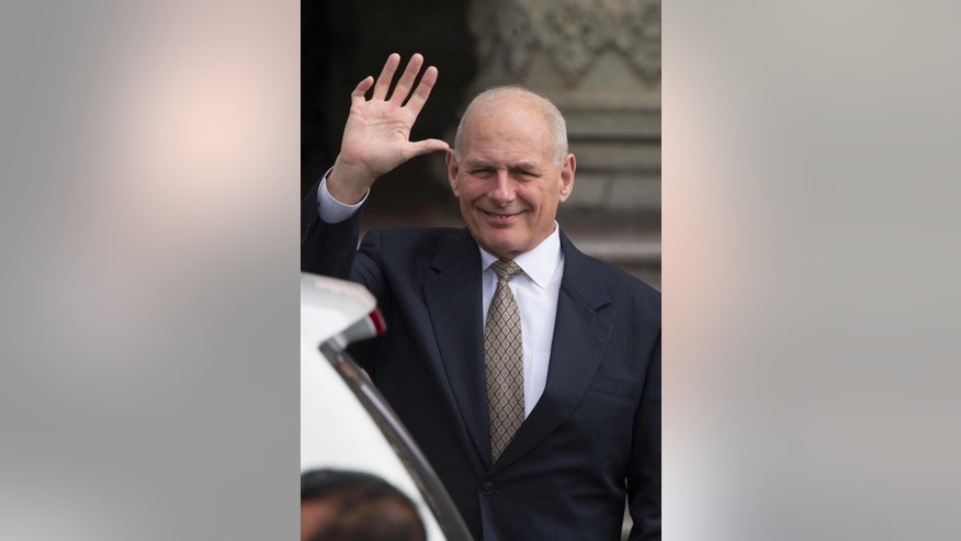 U.S. Secretary of Homeland Security John F. Kelly waves to photographers as he arrives to the National Palace for a meeting with Guatemala's President Jimmy Morales in Guatemala City, Wednesday, Feb. 22, 2017. Kelly is in Guatemala for a two day official visit. (AP Photo/Moises Castillo)