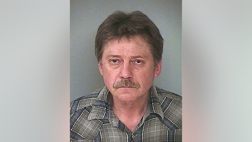 In this photo provided by Washington County, Md., Sheriff's Office, Edward Clarence Schneider is shown in a police booking photo March 15, 2016, in Hagerstown, Md. The California truck driver has been sentenced to 15 years in prison for shooting up a Hagerstown, Maryland, hotel room, sending bullets into nearby rooms, while he was high on crystal meth. (Washington County, Md., Sheriff's Office via AP.)