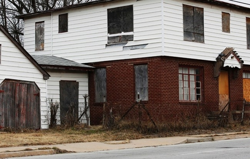 In this Thursday, Dec. 15, 2016, a boarded-up home is pictured in north Tulsa, Okla. After years of waiting for redevelopment opportunities that never came, members of the black business community are taking matters into their own hands, trying to recruit 100 small businesses to locate in north Tulsa to restore the luster of what once was. (AP Photo/Sue Ogrocki)