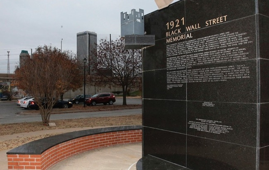 In this Thursday, Dec. 15, 2016 photo, a memorial to Tulsa's Black Wall Street sits outside the Greenwood Cultural Center on the outskirts of downtown Tulsa, Okla. A once-prosperous section of Tulsa that became the site of one of the worst race riots in American history is attempting to remake itself again after decades of neglect. Black leaders want to bring 100 new companies to the former Black Wall Street in north Tulsa by 2021, the 100th anniversary of its fall. (AP Photo/Sue Ogrocki)