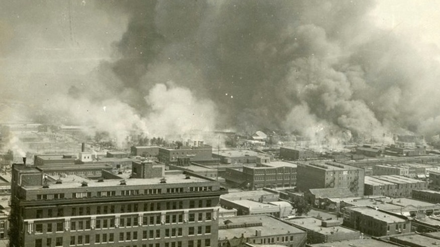 The Greenwood neighborhood of Tulsa, Okla., is burned down during a race riot in 1921.