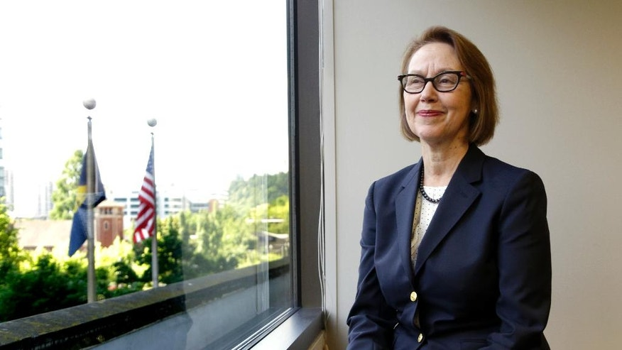 FILE - In this July 13, 2016, Oregon Attorney General Ellen Rosenblum poses for a photo at her office in Portland, Ore. Rosenblum has staffers strategizing how to fight back if the federal government tries to withhold funds to force compliance with conservative policies, like on abortion.  (AP Photo/Don Ryan, File)