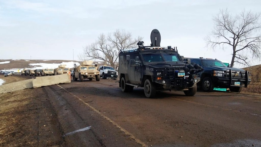 Law enforcement vehicles arrive at the closed Dakota Access pipeline protest camp near Cannon Ball, N.D., Thursday, Feb. 23, 2017, where dozens of people remain. Most protesters left peacefully Wednesday when authorities closed the camp on Army Corps of Engineers land in advance of spring flooding, but some are refusing to go. (AP Photo/James MacPherson)