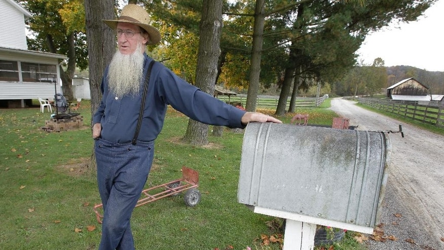 FILE - In this Oct. 10, 2011, file photo, Samuel Mullet Sr. stands in front of his home in Bergholz, Ohio. The U.S. Supreme Court decided Tuesday, Feb. 21, 2017, not to review Mullet's conviction as leader of a breakaway group prosecuted for hair- and beard-cutting attacks on fellow Amish in 2011, and serving a nearly 11-year sentence in federal prison in Elkton, Ohio. (AP Photo/Amy Sancetta, File)
