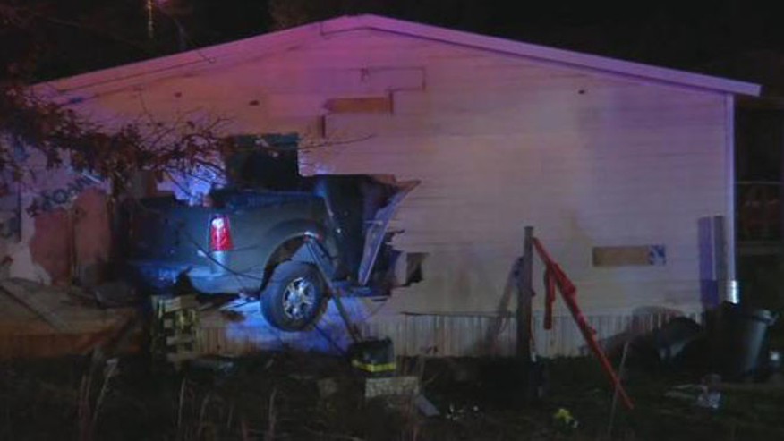 A truck crashed into the side of an Anderson County home in South Carolina Thursday night. (FOX Carolina)