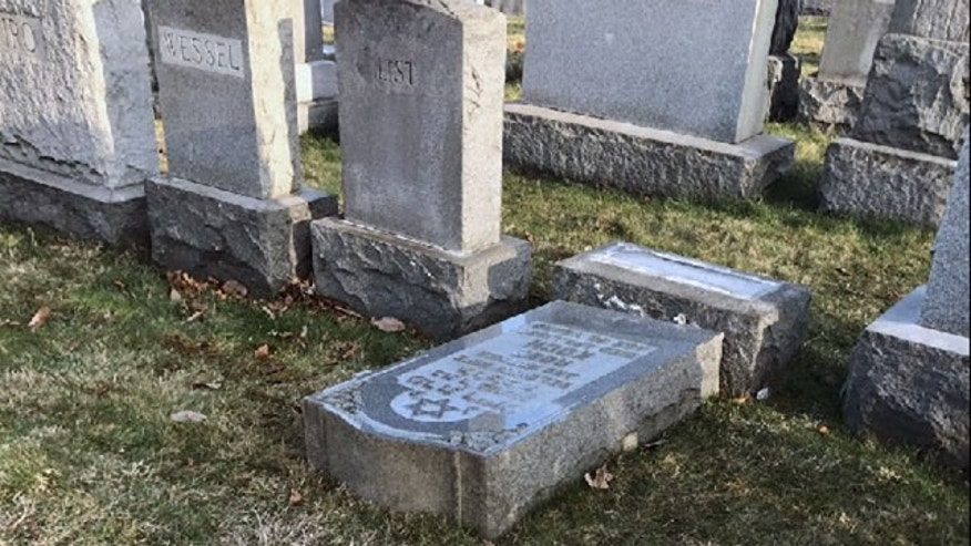 Feb. 26, 2017: The tombstone of a Jewish person lies on the ground at Mount Carmel Cemetery in Frankford, Pa.