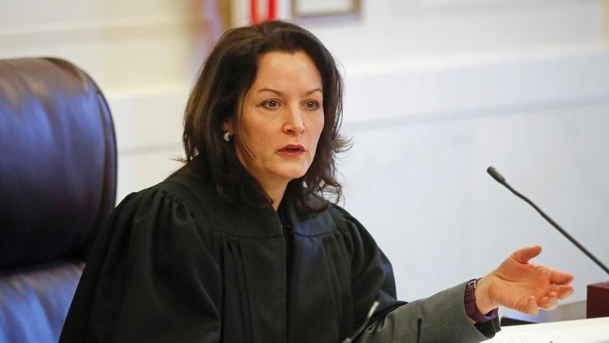 FILE – In this Jan. 23, 2017, file photo, Hamilton County, Ohio, Common Pleas Court Judge Leslie Ghiz meets with attorneys concerning the retrial of former University of Cincinnati police officer Ray Tensing in the July 19, 2015, traffic stop shooting death of motorist Samuel DuBose, during a hearing in Cincinnati. Ghiz scheduled a Monday, Feb. 27, 2017, meeting to get an update from prosecutors and defense attorneys before she presides over Tensing's retrial set to begin May 25, 2017, after the first trial ended with a hung jury. (AP Photo/John Minchillo, File)