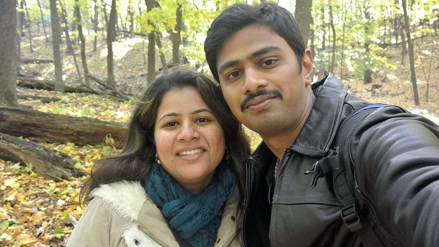 "In this undated photo provided by Kranti Shalia, Srinivas Kuchibhotla, right, poses for photo with his wife Sunayana Dumala in Cedar Rapids, Iowa. In the middle of a crowded bar, a 51-year-old former air traffic controller yelled at two Indian men - Kuchibhotla and Alok Madasani - to ""get out of my country,"" witnesses said, then opened fire in an attack that killed one of the men and wounded the other, as well as a third man who tried to help, Thursday, Feb 23, 2017, in Olathe, Kan. (Kranti Shalia via AP)"
